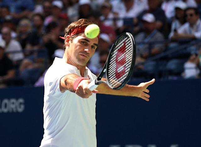 Straight sets: Five-time champion Roger Federer en route to a US Open third-round victory over Nick Kyrgios. (AFP Photo/TIMOTHY A. CLARY)