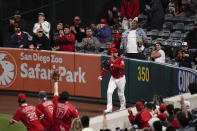 Fans cheer after Los Angeles Angels' Taylor Ward caught a fly ball hit by Tampa Bay Rays' Yandy Diaz during the sixth inning of a baseball game Thursday, May 6, 2021, in Anaheim, Calif. (AP Photo/Jae C. Hong)