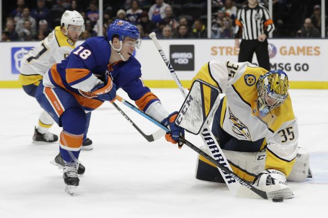 Nashville Predators goaltender Pekka Rinne (35) defends as New York Islanders' Anthony Beauvillier (18) attempts to score during the second period of an NHL hockey game Tuesday, Dec. 17, 2019, in Uniondale, N.Y. (AP Photo/Frank Franklin II)