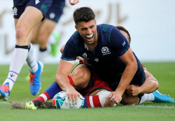 Scotland's Adam Hastings reacts after scoring a try (AP)