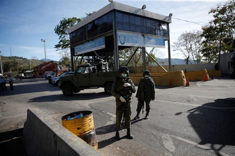 Members of the Bolivarian army stand at a checkpoint in response to the spread of coronavirus disease (COVID-19) in Caracas