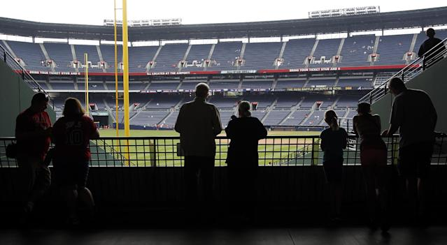 Fans watch batting practice before a baseball game between the Atlanta Braves and the San Diego Padres at Turner Field on Sunday, Sept. 15, 2013, in Atlanta. (AP Photo/Butch Dill)