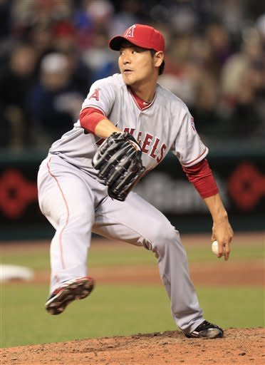 Los Angeles Angels' Hisanori Takahashi pitches in the seventh inning in a baseball game against the Cleveland Indians, Friday, April 27, 2012, in Cleveland. (AP Photo/Tony Dejak)