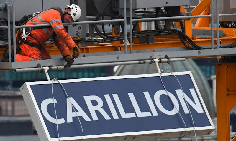 A Carillion sign is taken down from a construction crane in the City of London in January 2017 after the company went into liquidation