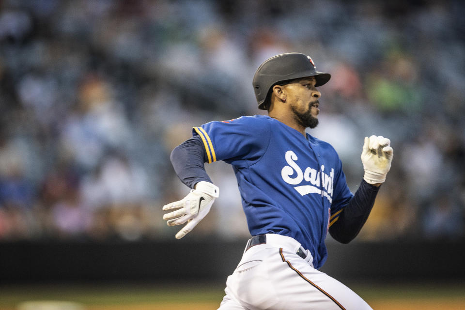 St. Paul Saints' Byron Buxton runs with a triple in the sixth inning against the Omaha Storm Chasers in a minor league baseball game Tuesday, June 8, 2021, in St. Paul, Minn. Buxton, of the Minnesota Twins, is on a rehab assignment. (Jerry Holt/Star Tribune via AP)