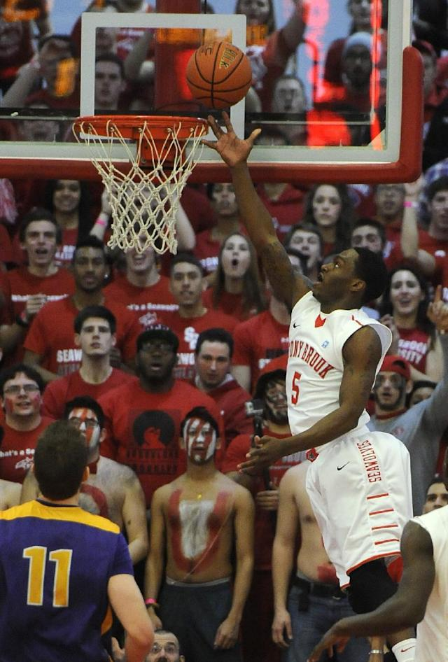 Stony Brook's Dave Coley (5) goes to the basket against Albany during the first half of an NCAA college basketball game in the championship of the America East Conference tournament Saturday, March 15, 2014, in Stony Brook, NY. (AP Photo/Kathy Kmonicek)