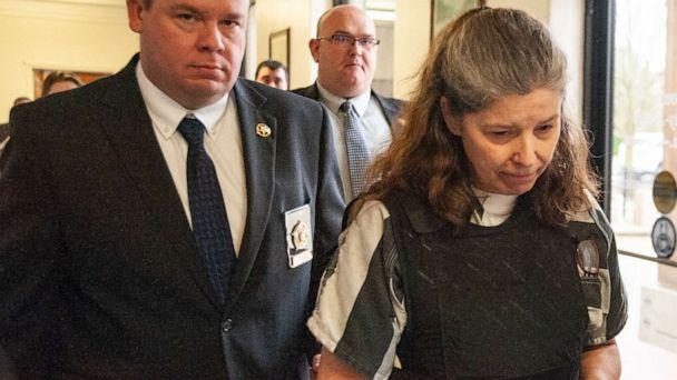 PHOTO: Rebecca O'Donnell is escorted down a hallway by Randolph County Sheriff Kevin Bell after a hearing on Wednesday, Jan. 29, 2020, at the Randolph County Courthouse in Pocahontas, Ark. (Alex Gladden/The Jonesboro Sun via AP, FILE)