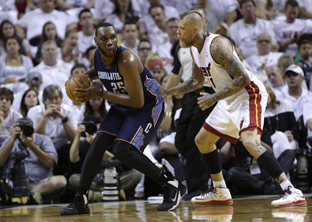 Charlotte Bobcats' Al Jefferson (25) looks to pass as Miami Heat's Chris Andersen (11) defends during the first half in Game 1 of an opening-round NBA basketball playoff series on Sunday, April 20, 2014, in Miami. (AP Photo/Lynne Sladky)