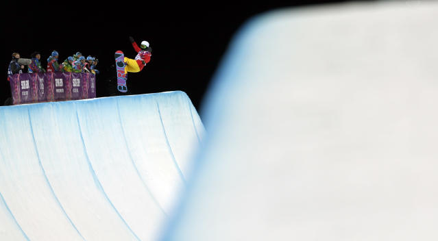 China's Li Shuang competes during the women's snowboard halfpipe final at the Rosa Khutor Extreme Park, at the 2014 Winter Olympics, Wednesday, Feb. 12, 2014, in Krasnaya Polyana, Russia. (AP Photo/Felipe Dana)