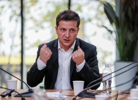 Ukraine's President Volodymyr Zelenskiy holds a press-marathon at a food market in Kiev