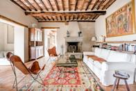 """If you're traveling with a slightly smaller group—a maximum of nine—then look into this renovated stone villa outside Montalcino, a 1.5-hour drive south of Florence. An Airbnb Plus, the decor is a mix of old and new, showcasing original features of the home like the ceilings and fire places while still bringing in modernity. The bedrooms offer a variety of sleeping options: there's one bunk room with three singles and three queen-size rooms. Visitors will also have access to outdoor living areas and a private pool overlooking the Tuscan hills. $1018, Airbnb (Starting Price). <a href=""""https://www.airbnb.com/rooms/plus/19839441"""" rel=""""nofollow noopener"""" target=""""_blank"""" data-ylk=""""slk:Get it now!"""" class=""""link rapid-noclick-resp"""">Get it now!</a>"""
