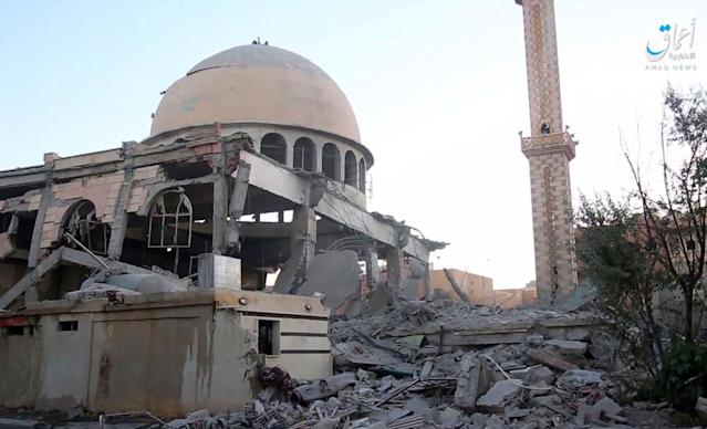<p>This undated frame grab from video posted online Saturday, June 10, 2017, by the Aamaq News Agency, a media arm of the Islamic State group, shows a mosque that was damaged by bombardment by the U.S.-led coalition and U.S.-backed fighters in the northern Syrian city of Raqqa. A U.S.-backed Syrian opposition force says it has captured a northwestern neighborhood in the northern city of Raqqa from the Islamic State group after two days of fighting. (Photo: Aamaq News Agency via AP) </p>