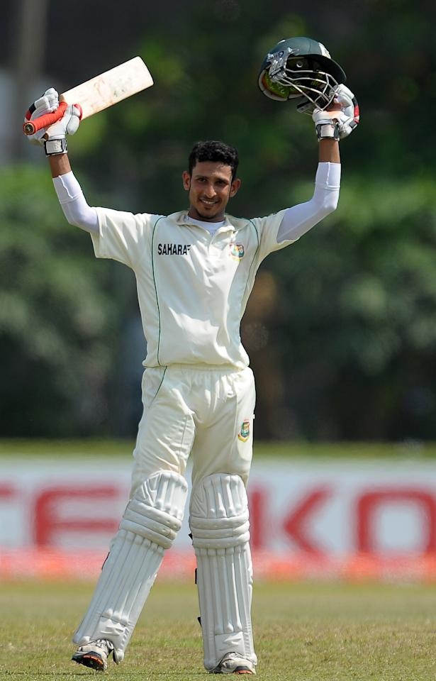 Bangladeshi cricketer Nasir Hossain raises his bat and helmet in celebration after scoring a century (100 runs) during the fourth day of the opening Test match between Sri Lanka and Bangladesh at the Galle International Cricket Stadium in Galle on March 11, 2013.   AFP PHOTO/ LAKRUWAN WANNIARACHCHI        (Photo credit should read LAKRUWAN WANNIARACHCHI/AFP/Getty Images)