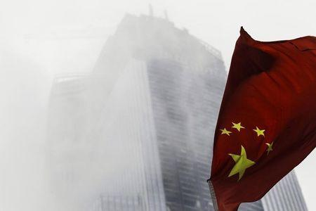 Chinese national flag flutters in front of a construction site in Guangzhou