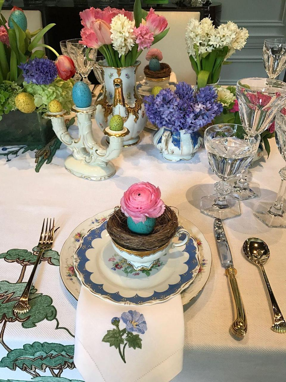 """<p>""""Bring beautiful spring scenery indoors with decorative birds' nests. You can set them inside tea cups with tiny decorative eggs on top of the nests, this was really a hit at my last Easter gathering. Here you can get creative and mix and match or just stick to a color palette. Try mixing and matching tea cups, creamer and sugar bowls and teapots instead of vases and display gorgeous spring floral arrangements to brighten up your table!"""" <em>—<a href=""""https://www.thetot.com/mama/being-mama-nasiba-adilova/"""" rel=""""nofollow noopener"""" target=""""_blank"""" data-ylk=""""slk:Nasiba Adilova"""" class=""""link rapid-noclick-resp"""">Nasiba Adilova</a>, Founder, The Tot</em></p>"""
