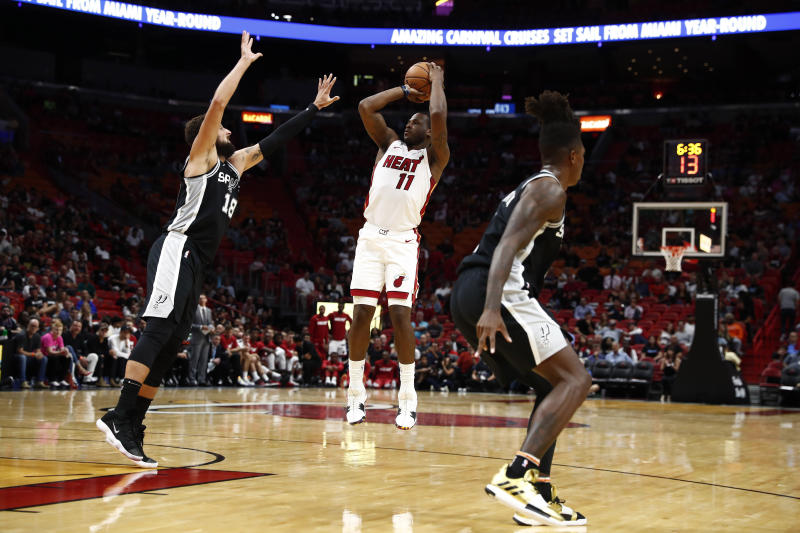 Miami Heat guard Dion Waiters (11) shoots the ball against San Antonio Spurs guard Marco Belinelli (18) during the second half of an NBA preseason basketball game on Tuesday, Oct. 8, 2019, in Miami. (AP Photo/Brynn Anderson)