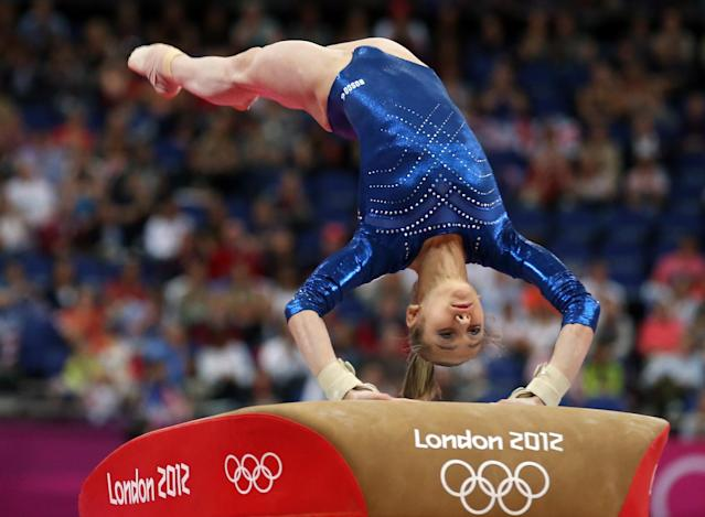 LONDON, ENGLAND - AUGUST 02: Victoria Komova of Russia competes on the vault in the Artistic Gymnastics Women's Individual All-Around final on Day 6 of the London 2012 Olympic Games at North Greenwich Arena on August 2, 2012 in London, England. (Photo by Streeter Lecka/Getty Images)