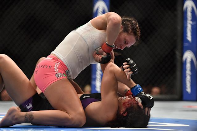 (Top) Cat Zingano elbows Amanda Nunes in their women's bantamweight fight during the UFC 178 event inside the MGM Grand Garden Arena on September 27, 2014 in Las Vegas, Nevada. (Getty Images)