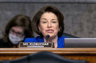 Chairwoman Amy Klobuchar, D-Minn., speaks at the start of a Senate Homeland Security and Governmental Affairs & Senate Rules and Administration joint hearing on Capitol Hill, Washington, Tuesday, Feb. 23, 2021, to examine the January 6th attack on the Capitol. (AP Photo/Andrew Harnik, Pool)