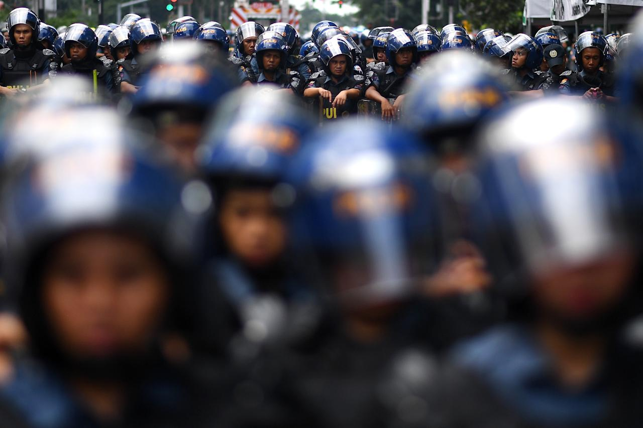 <p>Philippine riot police stand guard during a protest against US President Donald Trump ahead of the 31st Association of Southeast Asian Nations (ASEAN) Summit in Manila on Nov. 11, 2017. (Photo: Manan Vatsyayana/AFP/Getty Images) </p>