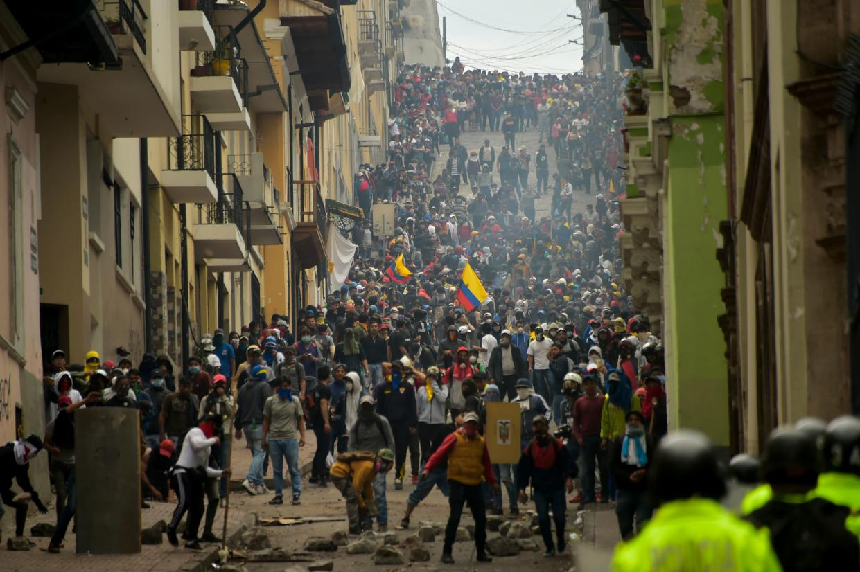 Demonstrators clash with riot police in Quito, as thousands march against Ecuadorean President Lenin Moreno's decision to slash fuel subsidies, on Oct. 9, 2019. (Photo: Rodrigo Buendia/AFP via Getty Images)