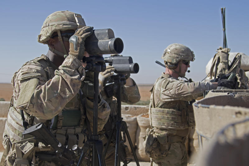 In this Nov. 1, 2018, photo released by the U.S. Army, soldiers surveil the area during a combined joint patrol in Manbij, Syria. (ASSOCIATED PRESS)