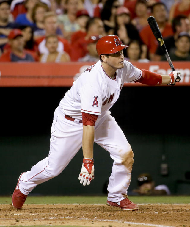Los Angeles Angels' David Freese hits a two-run double against the Houston Astros during the fourth inning of a baseball game in Anaheim, Calif., Thursday, July 3, 2014. (AP Photo/Chris Carlson)