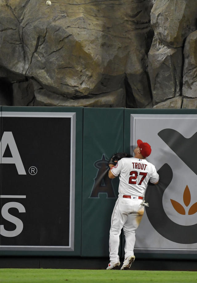 Los Angeles Angels center fielder Mike Trout watches a ball hit by Pittsburgh Pirates' Bryan Reynolds go out for a solo home run during the seventh inning of a baseball game Tuesday, Aug. 13, 2019, in Anaheim, Calif. (AP Photo/Mark J. Terrill)