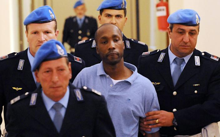 Rudy Guede has been released early to serve the remainder of his sentence via community service - TIZIANA FABI/AFP