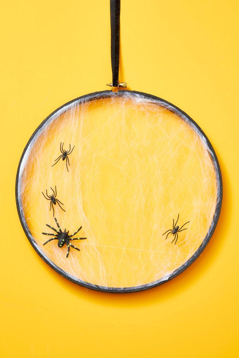 "<p>Hang one or multiple of this simple cobweb wreaths on your door this Halloween season. <br><strong><br>Make the Wreath: </strong>Stretch faux cobweb over the inner ring of a 12-inch embroidery hoop; add out ring to hold in place. Trim any excess web from the back and add a few small faux spiders to the front. <br><br><a class=""link rapid-noclick-resp"" href=""https://www.amazon.com/Kangaroos-Strechy-Spider-Web-Foot/dp/B071V6K6CV/ref=sr_1_1?tag=syn-yahoo-20&ascsubtag=%5Bartid%7C10050.g.22350299%5Bsrc%7Cyahoo-us"" rel=""nofollow noopener"" target=""_blank"" data-ylk=""slk:SHOP SPIDER WEB"">SHOP SPIDER WEB</a><br></p>"