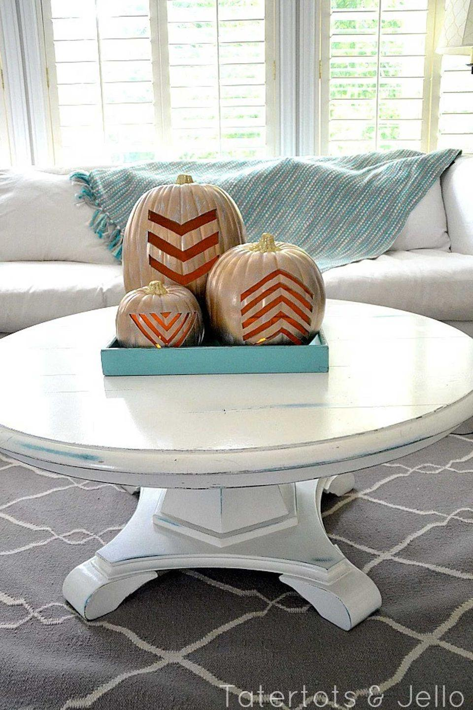 "<p>Pumpkins aren't just for the porch—with some gold spray paint, you can make them look living-room ready.</p><p><strong>Get the tutorial at <a href=""http://tatertotsandjello.com/2013/09/make-gold-carvable-geometric-pumpkins-fall.html"" rel=""nofollow noopener"" target=""_blank"" data-ylk=""slk:Tatertots & Jello"" class=""link rapid-noclick-resp"">Tatertots & Jello</a>.</strong></p>"