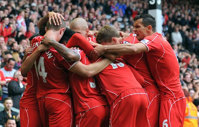 Liverpool players celebrate a goal during a match in Liverpool, England on August 17, 2014 (AFP Photo/Paul Ellis)