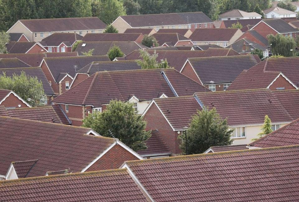 Through the roofs:  Borrowers could save more than £490m every year  (PA)