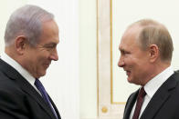 Russian President Vladimir Putin, right, and Israeli Prime Minister Benjamin Netanyahu greet each other during their meeting in the Kremlin in Moscow, Russia, Wednesday, Feb. 27, 2019. The talks are expected to focus on the situation in Syria. (Maxim Shemetov/Pool Photo via AP)