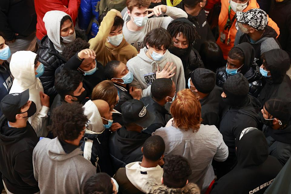 <p>Shoppers wait for a video games store to open on Black Friday, at the Tysons Corner Center in Virginia on 27 November, 2020</p> (REUTERS)