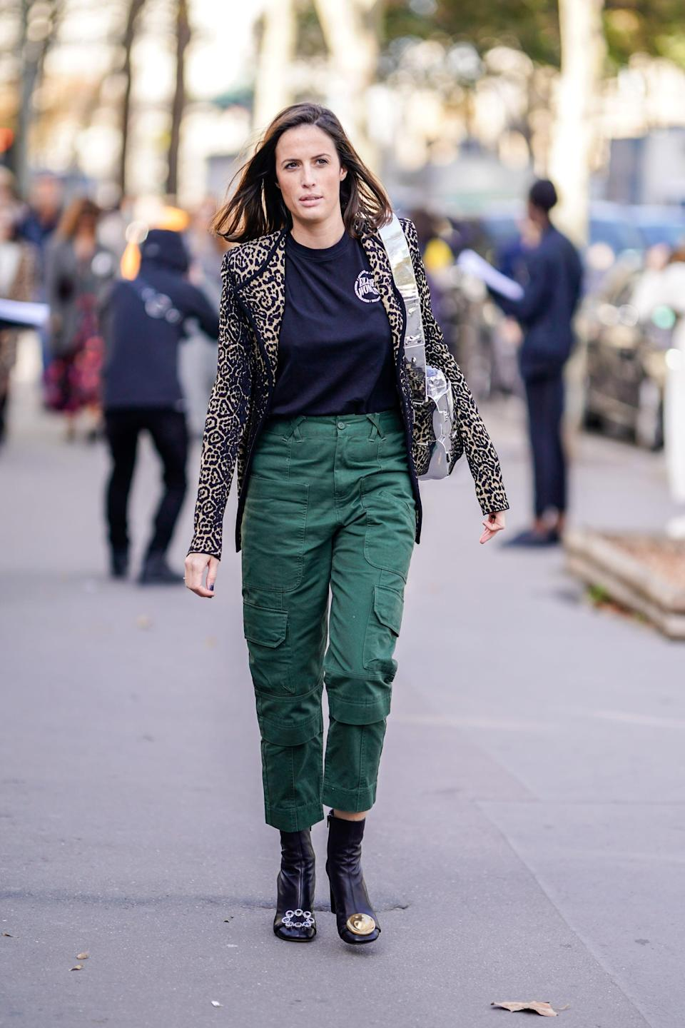 <p>Feeling fashion-forward? Top a sporty pair of cargos with a blazer and add ankle boots for the finish. </p>