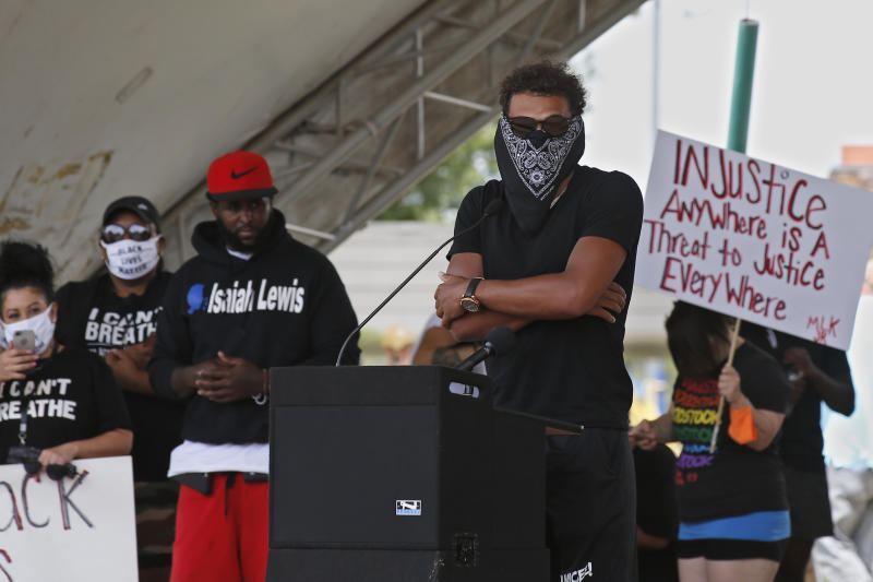 Atlanta Hawks guard Trae Young, center, speaks during a peaceful rally Monday, June 1, 2020, in his hometown of Norman, Okla., calling attention to the killing of George Floyd by Minneapolis police on May 25. (AP Photo/Sue Ogrocki)