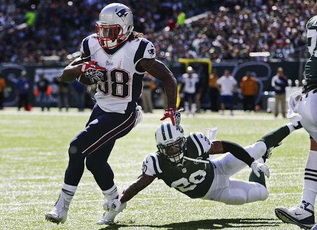 New England Patriots' Brandon Bolden (38) runs away from New York Jets' Kyle Wilson (20) for a touchdown during the first half of an NFL football game Sunday, Oct. 20, 2013 in East Rutherford. (AP Photo/Seth Wenig)