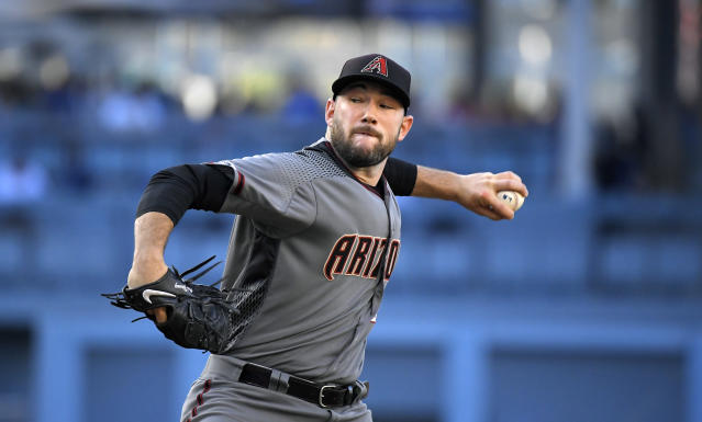 Arizona Diamondbacks starting pitcher Alex Young throws to the plate during the first inning of a baseball game against the Los Angeles Dodgers, Saturday, Aug. 10, 2019, in Los Angeles. (AP Photo/Mark J. Terrill)