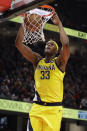 Indiana Pacers' Myles Turner dunks the ball against the Cleveland Cavaliers in the second half of an NBA basketball game, Saturday, Feb. 29, 2020, in Cleveland. Indiana won 113-104. (AP Photo/Tony Dejak)