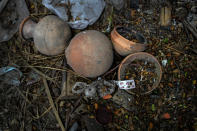 Earthen pots used during the cremation of a deceased COVID-19 victim lie in a cremation ground in Gauhati, India, Friday, July 2, 2021. The personal belongings of cremated COVID-19 victims lie strewn around the grounds of the Ulubari cremation ground in Gauhati, the biggest city in India's remote northeast. It's a fundamental change from the rites and traditions that surround death in the Hindu religion. And, perhaps, also reflects the grim fears grieving people shaken by the deaths of their loved ones — have of the virus in India, where more than 405,000 people have died. (AP Photo/Anupam Nath)