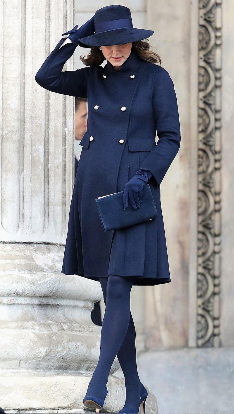 December 14: A darker blue on display here! This is a rare fully matching look from Kate (the gloves! The handbag! The hat!) that is frankly killer.