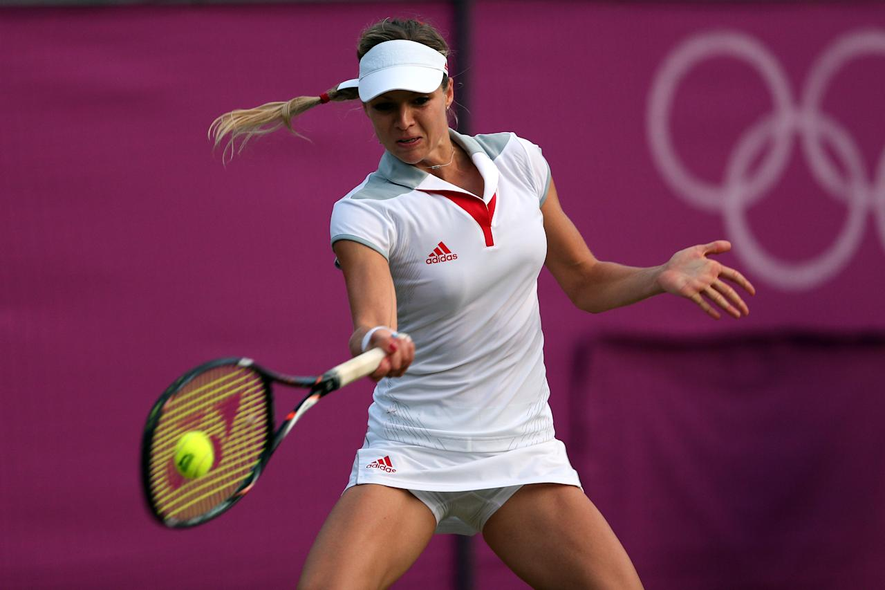 LONDON, ENGLAND - JULY 31:  Maria Kirilenko of Russia returns a shot against Heather Watson of Great Britain during the second round of Women's Singles Tennis on Day 4 of the London 2012 Olympic Games at Wimbledon on July 31, 2012 in London, England.  (Photo by Clive Brunskill/Getty Images)