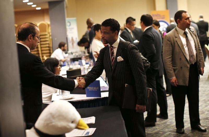 A job seeker meets with a prospective employer at a career fair in New York City