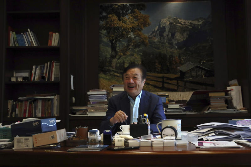 In this Aug. 20, 2019, photo, Huawei's founder Ren Zhengfei stirs his coffee as he reacts to visitors at his office on the Huawei campus in Shenzhen in Southern China's Guangdong province. Ren says its troubles with President Donald Trump are hardly the biggest crisis he has faced while working his way from rural poverty to the helm of China's first global tech brand. (AP Photo/Ng Han Guan)