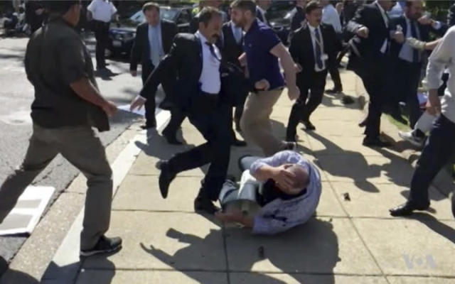 Members of Turkish President Recep Tayyip Erdogan's security detail are shown violently reacting to protesters during his trip to Washington in May. (Voice of America via AP)