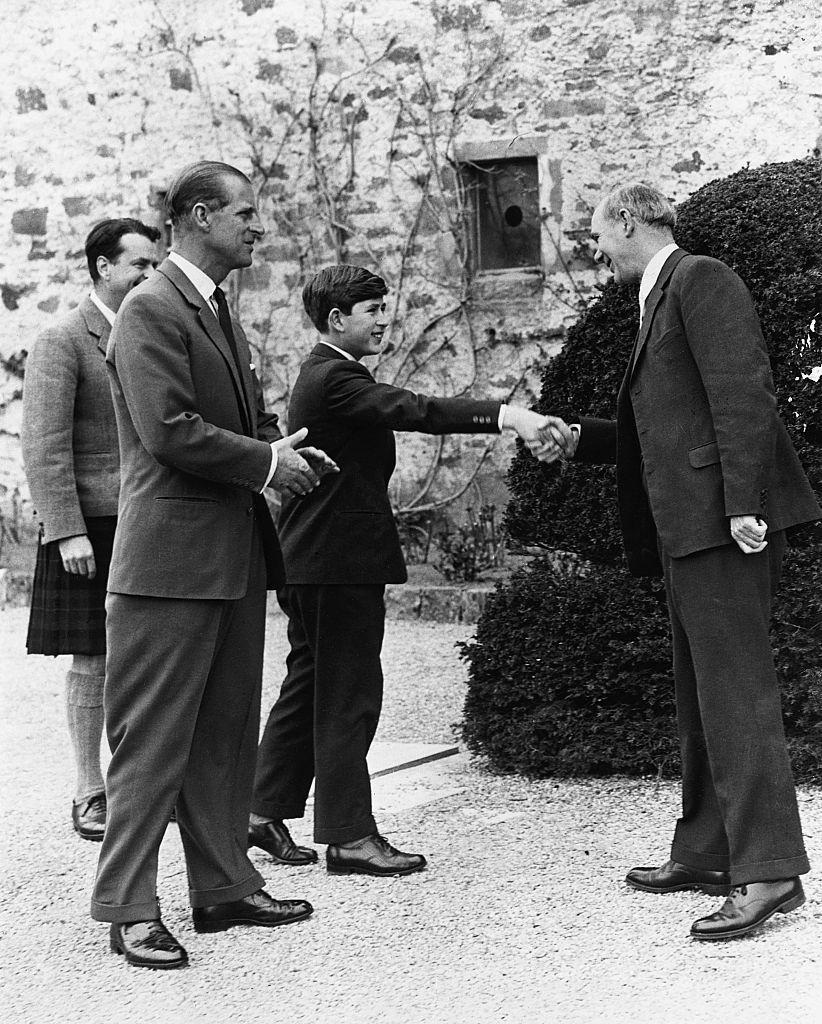 <p>The Duke of Edinburgh joined Prince Charles as he greets the headmaster on his first day at Gordonstoun School.</p>