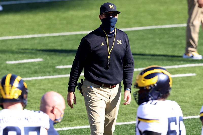 Michigan coach Jim Harbaugh walks on the field during warm ups before the game against Indiana, Saturday, Nov. 7, 2020, in Bloomington, Ind.