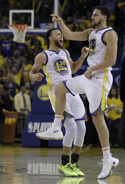 Golden State Warriors' Stephen Curry, left, and Klay Thompson celebrate during the second half of Game 5 of a second-round NBA basketball playoff series against the Houston Rockets Wednesday, May 8, 2019, in Oakland, Calif. (AP Photo/Ben Margot)