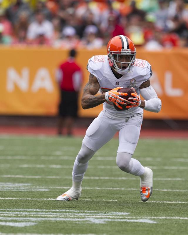 After stripping the ball from Philadelphia Eagles Desean Jackson (10), of Team Sanders, Cleveland Browns cornerback Joe Haden (23), of Team Rice, runs the ball down the field during the second quarter at the NFL Pro Bowl football game at Aloha Stadium, Sunday. Jan. 26, 2014, in Honolulu. (AP Photo/Marco Garcia)